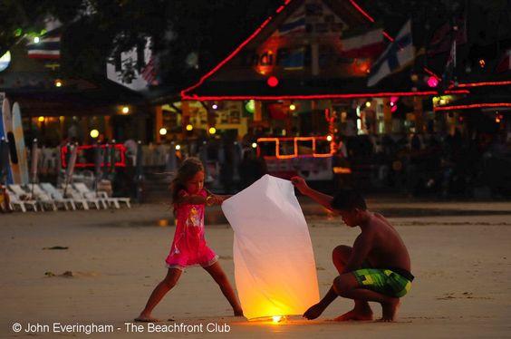 lighting up the lantern, at Kata Beach, Phuket