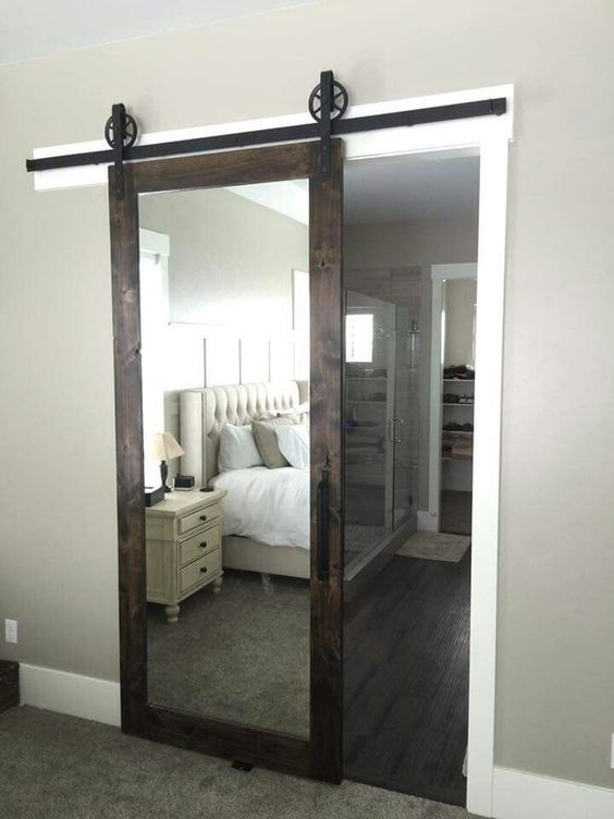 Love this mirrored barn door for a master bedroom dream for Tub in master bedroom