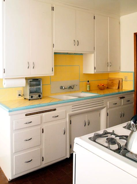Love this simple, retro kitchen that hasn't been torn out ...