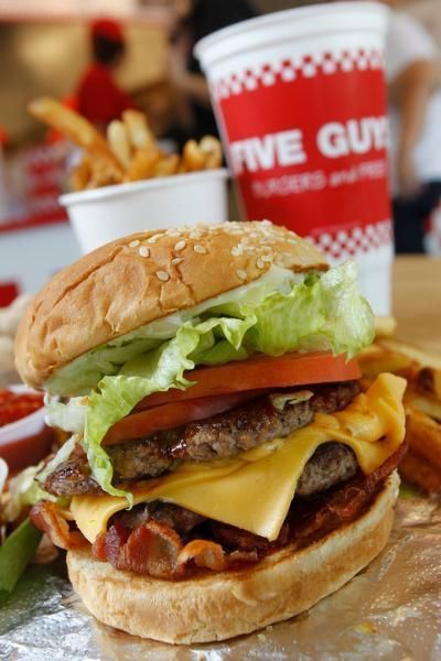 The double patty cheeseburger with lettuce, tomato, bacon barbecue sauce and mayo at Five Guys Burgers and Fries, a return contender.: