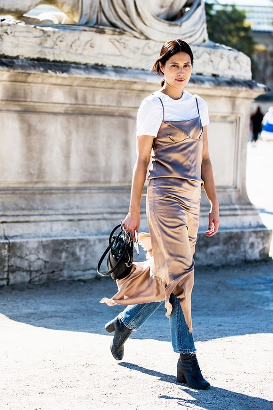 Slip Dresses via @WhoWhatWear. Layered with jeans AND a white tee.: