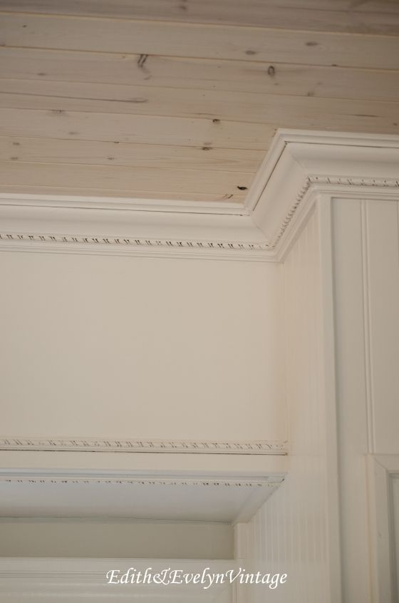 Covering outdated soffits with wood and molding!
