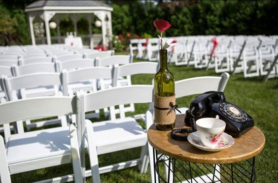 Ceremony decor, rotary phone, telephone table, tea cup and saucer.