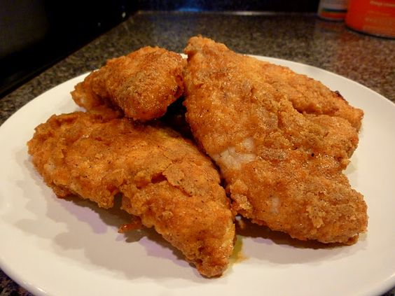 BAKED FRIED CHICKEN! This is a family favorite and tastes just like KFC! The good part....no skin & no frying! These Chicken tenders are baked and simply divine! A sure family pleaser!