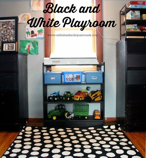 Black and White and Toys all Over!  Click to see unique toy storage and organization ideas in a cute, little playroom.