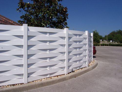 Basket weave white horizontal vinyl fencing landscape