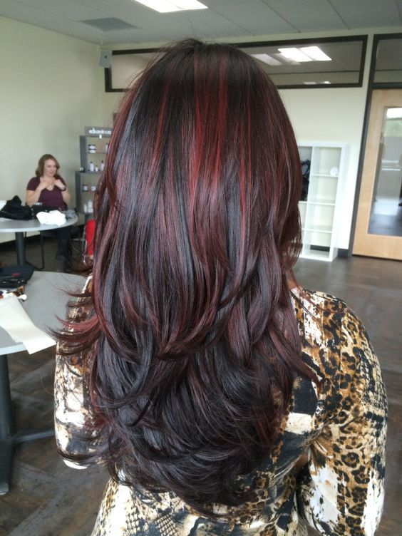 Layered Black Waves With Muted Cherry Highlights Hair Color For Black Hair Hair Highlights Black Hair With Highlights