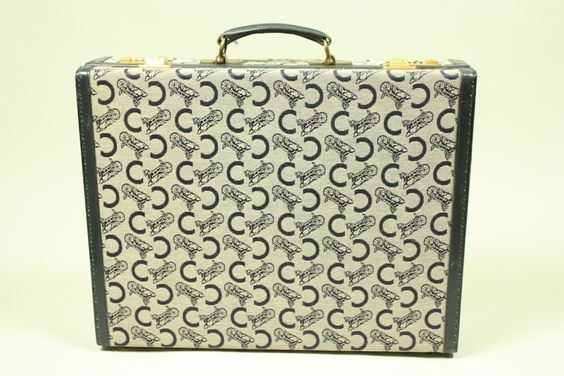 1970's Celine Monogrammed Suitcase | From a collection of rare vintage briefcases and attachés at https://www.1stdibs.com/fashion/handbags-purses-bags/briefcases-attaches/