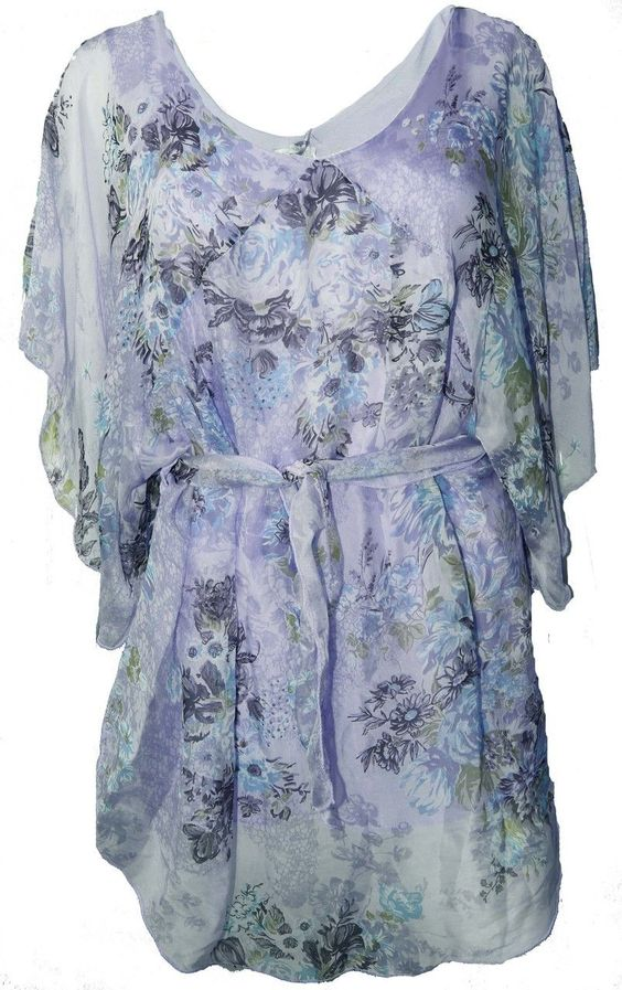 Blue Floral silk tunic via Bellíssima. Click on the image to see more!