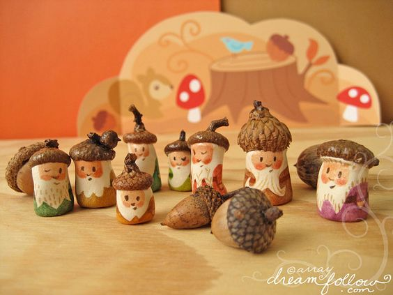 "Acorn-capped painted miniature wooden NÖM figures, by Aimee Ray of dreamfollow.com and archived on her Flickr feed, where her handle is ""merwing"" (8 Nov. 2010). #peg people #peg doll #gnome:"