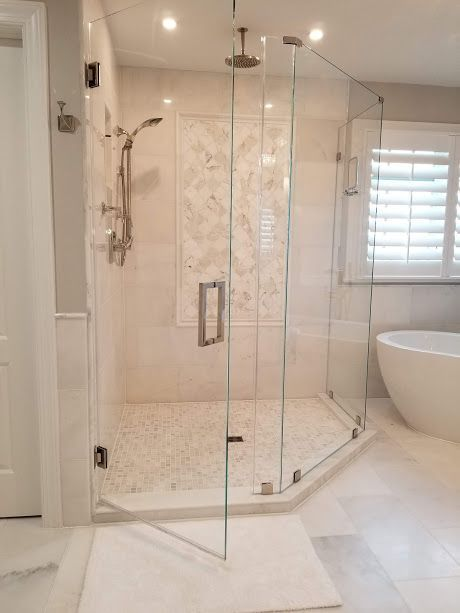 Light Colored Master Bath With Frameless Glass Shower Doors The Free Standing Tub Give Glass Shower Doors Frameless Master Bathroom Shower Glass Shower Doors