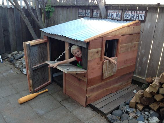 My grandson's new fort!! A converted small wood shed that was covered with remnants from a local redwood mill.