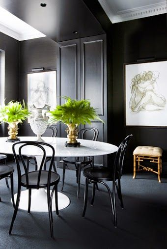 What a great illustration of the crisp contrast with black and white. Barbara Wirth Art gives a thumbs up to the coordinating art. But this room wouldn't pop without the fresh green in the plants. Well done!