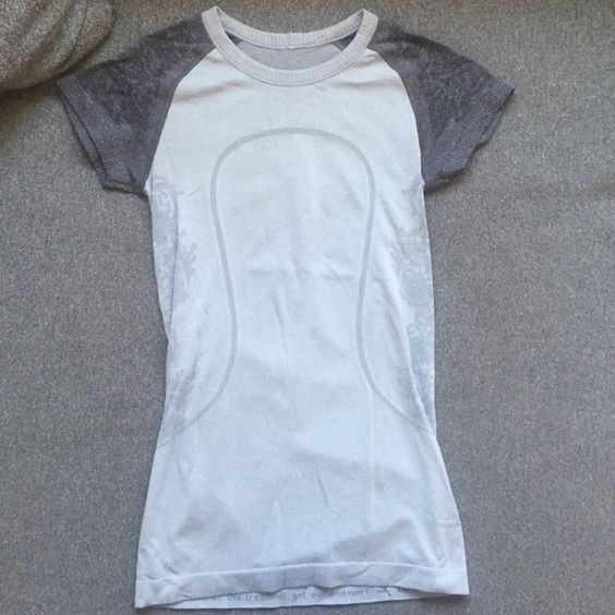 Lululemon short sleeve Great condition - only one tiny snag in front - shown in pic. Size 4 lululemon athletica Tops