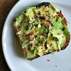 avocado toast with chili pepper flakes and crushed pistachios. nom.