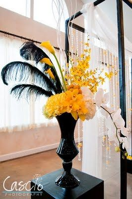 Very chic--does incorporate pricier floral but we could scale down. Adapt for lower centerpieces as well.