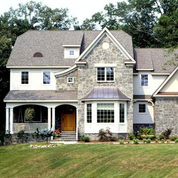 This Modified English Country Cottage Conveys Stability With Its Massive Masonry Exterior And Tall Casement Wi Cottage Style Homes House Exterior Cottage Style