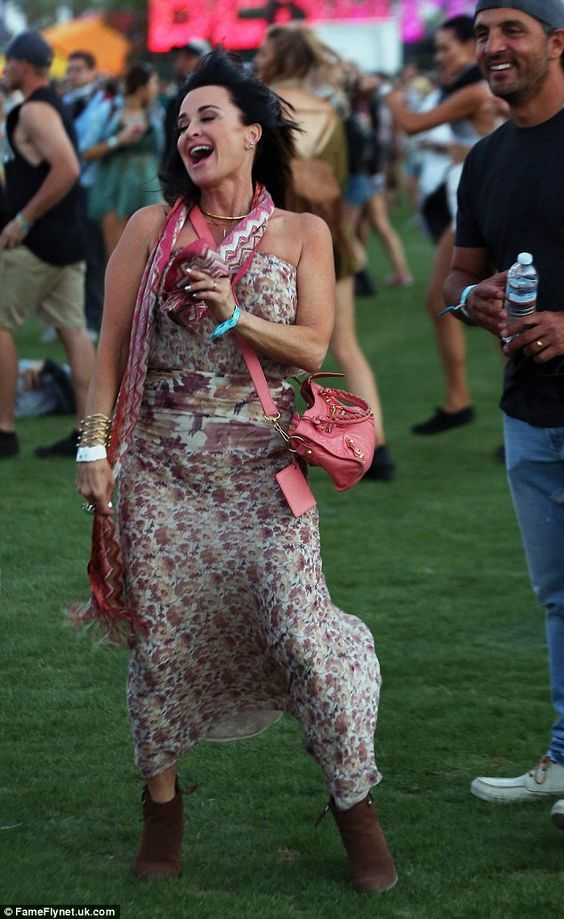 Let the games begin! Kyle Richards had a huge smile on her face as she danced beside her husband Mauricio Umansky alongside a crowd of other revelers on Friday afternoon