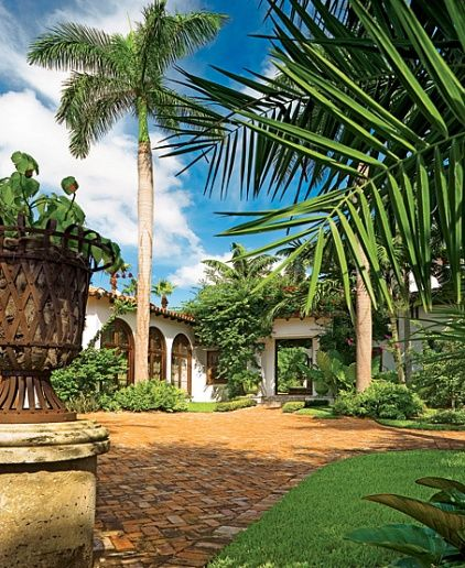 beautiful brick paved driveway Mediterranean home