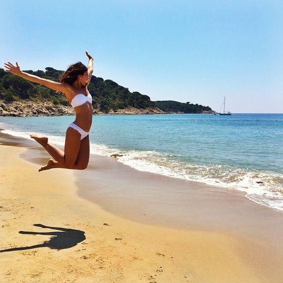 Mimi Ikonn | Cote d'Azur, France. Jumping on the beach | White bikini | Travel | Full video here: http://www.mimiikonn.com/blog/2015/6/14/south-of-france-speaking-russian?rq=france