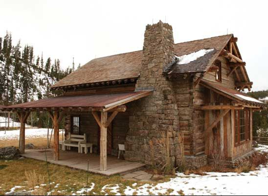 So very tiny and so very cute reclaimed antique log home transformed into a guest house in Montana. Love that stacked stone fireplace.: