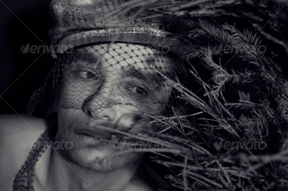 Portrait of a young handsome man (beauty, black, black background, boys, caucasian, cute, elegant, european, fabric cover, handsome, head, look, looking, male, man, model, monochrome, one, people, person, portrait, staring, studio, style, twigs, veil, white, young)