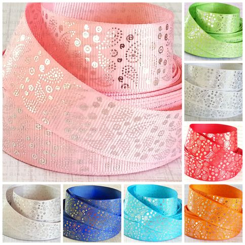 """US Designer fantastic quality grosgrain ribbon. This ribbon has silver foiled paisley throughout the design. Size is 7/8"""" and you will get 1 complete yard of this high quality ribbon! An absolute must have to add to your crafting inventory.  **If you are interested in any product in my inventor..."""