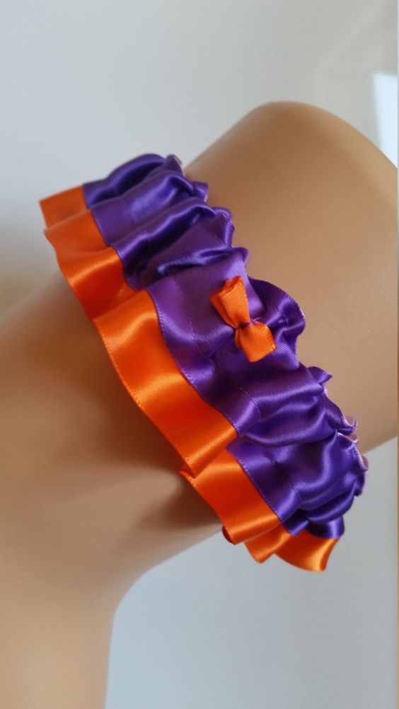 Check out this item in my Etsy shop https://www.etsy.com/ca/listing/463898702/purple-and-orange-garter-royal-purple