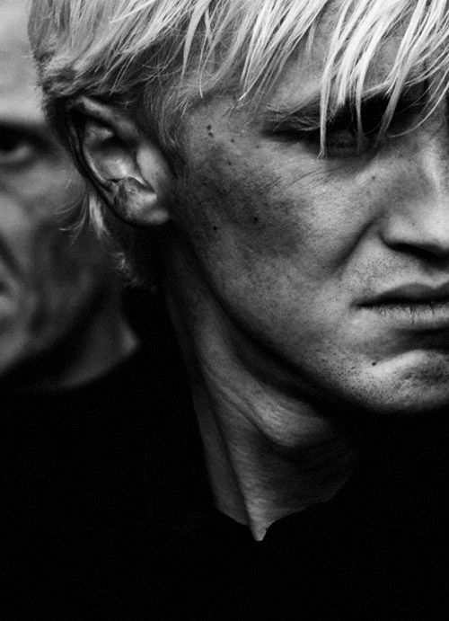 Draco Malfoy. I love the quality of this photo, along with the position and emotion in it.