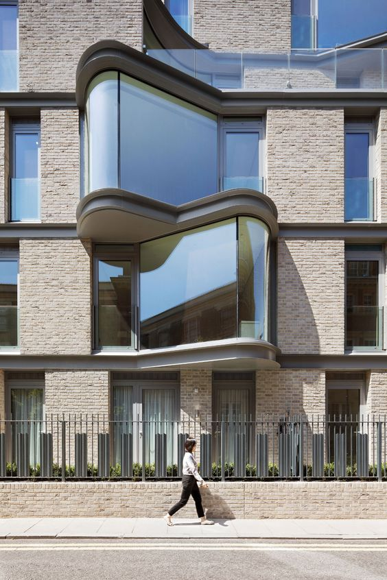 DROO designs London apartment block with dramatic curved window bays
