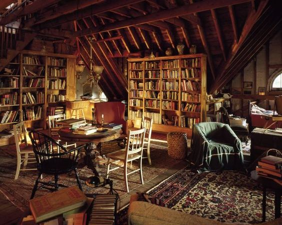 This imaginative homeowner made good use of some unused space in his Kennebunk, Maine attic. Creating a library/study using old furniture, simple bookshelves, oriental rugs and other items to make this space a cozy and interesting place to read or just hang out and relax. Sometimes it doesn't take much, just a little creativity.: