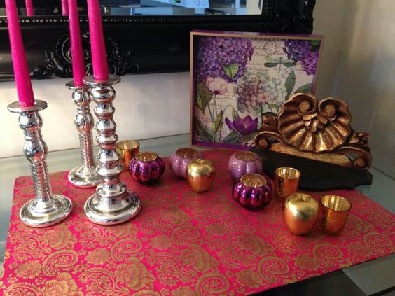 Stunning display pink candles and gold palette