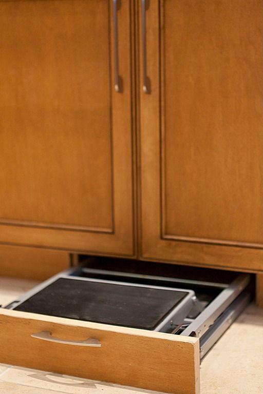 Built in step stool  http://www.zillow.com/digs/Freeman-Kitchen-Bath-Home-boards/Transitional-Kitchen-in-FL/#url=%2Fdigs%2Fkitchens-5213522052%2F&id=5213522052