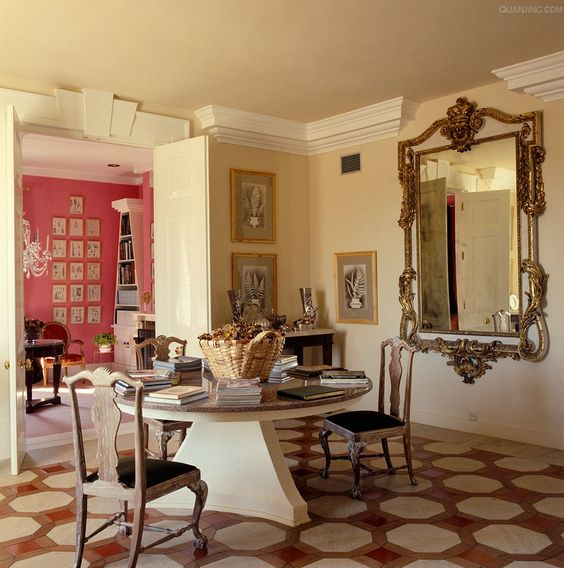 Oversize gilt mirror and patterned floor in English designer David Hicks home: