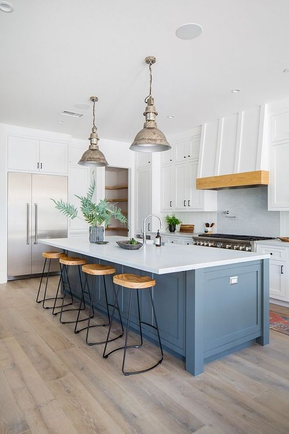 This kitchen is full of great ideas! I love this large island and the custom hood. Island paint color is Farrow and Ball Down Pipe. Note: This color looks darker in person than we see in this picture.