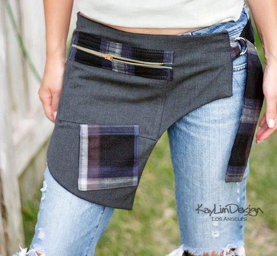 -This is a hand-made/one-of-a-kind piece, so each one will have unique details  -Gray polyester, Navy lining with Navy plaid pleats  -Three pockets (Big one with zipper closure, two cell phone size pockets)  -Adjustable (hip measurement needed for custom order)