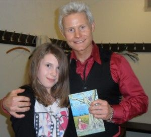 """""""I'm very proud to be associated with it.  My mother is a huge fan of this book, and she's Director of Wales, Carers Trust.    Congratulations to everybody involved, particularly Victoria and of course the lady who it's about really; Adele.  God Bless You!""""      Rhydian Roberts  (Pictured with Adele-Caitlin Taylor)"""