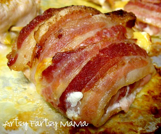 Bacon Wrapped Chicken:Put Cream cheese, garlic powder, and cheddar cheese on chicken, wrap in bacon. Bake 400 for 45 mins, turn halfway through. Then broil to make sure bacon is crispy!