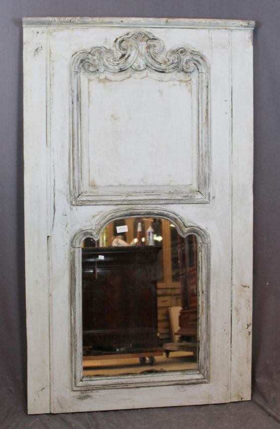 """French, 19th century. An antique French Louis XV trumeau mirror in painted finish.  55 3/4""""h x 33""""w"""