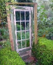 DOOR instead of a gate! love this idea, would work better with A WOODEN FENCE SO IT DOESNT LOOK FLOATING!
