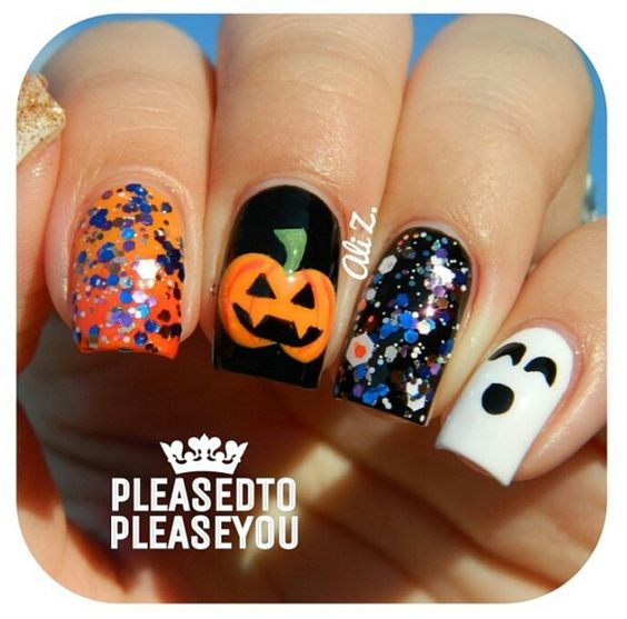 Halloween nails. That ghost is cute and looks easy to do! Think I'll do all my nails purple and have the index finger be the ghost.