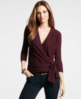 3/4 Sleeve Wrap Sweater - A perfect mix-and-match wearable, this always flattering (and ultra cozy) wrap sweater pairs perfectly with the season's slim fit styles. V-neck with crossover front. 3/4 sleeves. Self-tie waist.