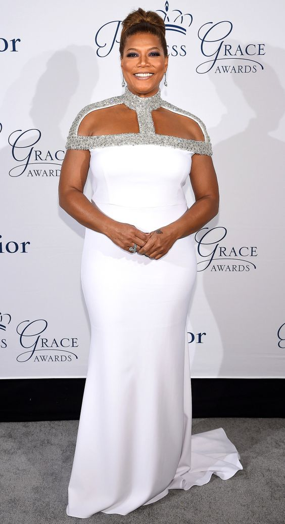 QUEEN LATIFAH accepting her honor from the Princess Grace Foundation in N.Y.C. wearing a Christian Siriano column with a cutout high-necked silver bodice.