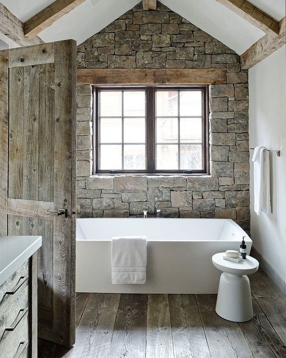 Love the stone used in this modern rustic bathroom. Wood beams and ...