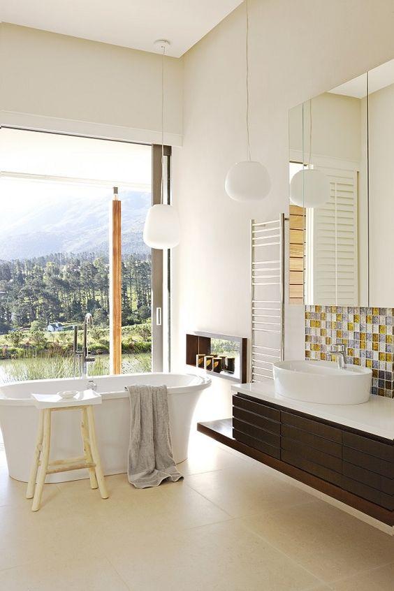 Using a frameless mirror creates a streamlined effect, bringing  a modern minimalist look to  bathroom home décor.