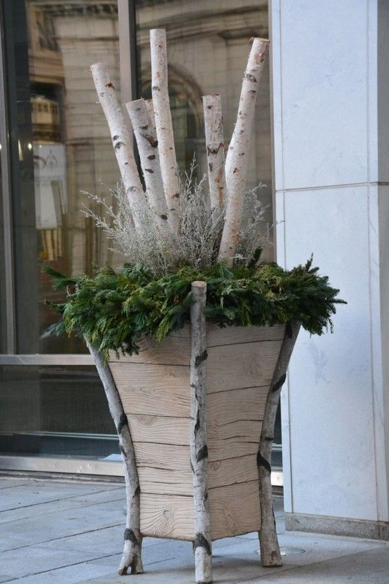 Upcycling old wood into a planter for a winter container #christmas  #containers #planters #gardenplanters #Log #birch
