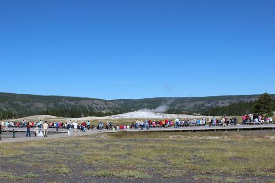 Watching the Old Faithful Geyser eruption in Yellowstone National Park is one of the things you must do if you plan to visit this park. This post shows the eruption in photos.