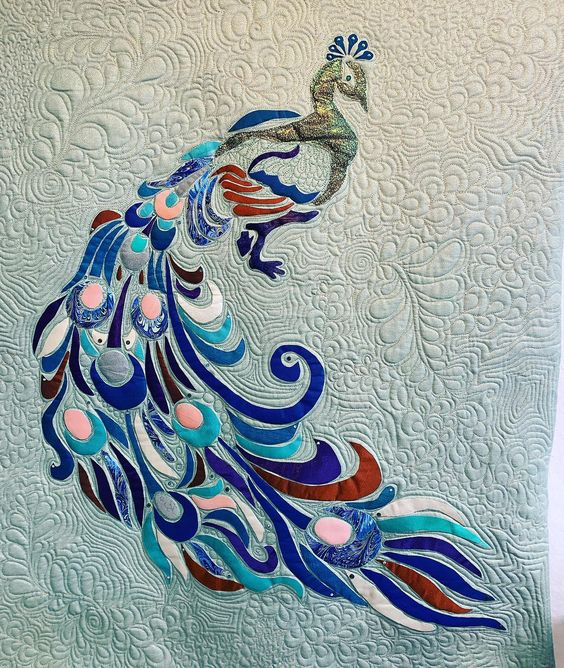 """This is """"Standout"""" made for my mom's 80th birthday.   All designed, appliqued and custom quilted by me.  Fabrics are satins, cottons, tafetas, silks, and a few handpainted by me.   #appliquequilt #applique #quilting #quiltingismytherapy #artquilt #peacock  #sparkly #threads #fabric #freemotionquilting. #handiquilter"""