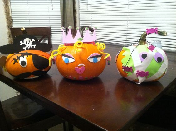Used foam stickers and pipe cleaners to decorate pumpkins this year. No knives, no glue and very little mess!