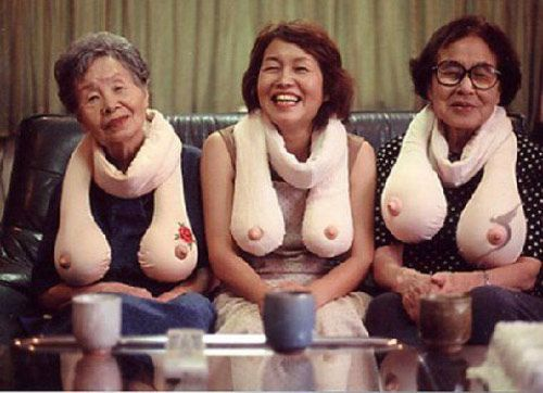 hmmmm, wonder if Deb can makes these.....Boob scarves. Evidently they come in different sizes and with tattoos.